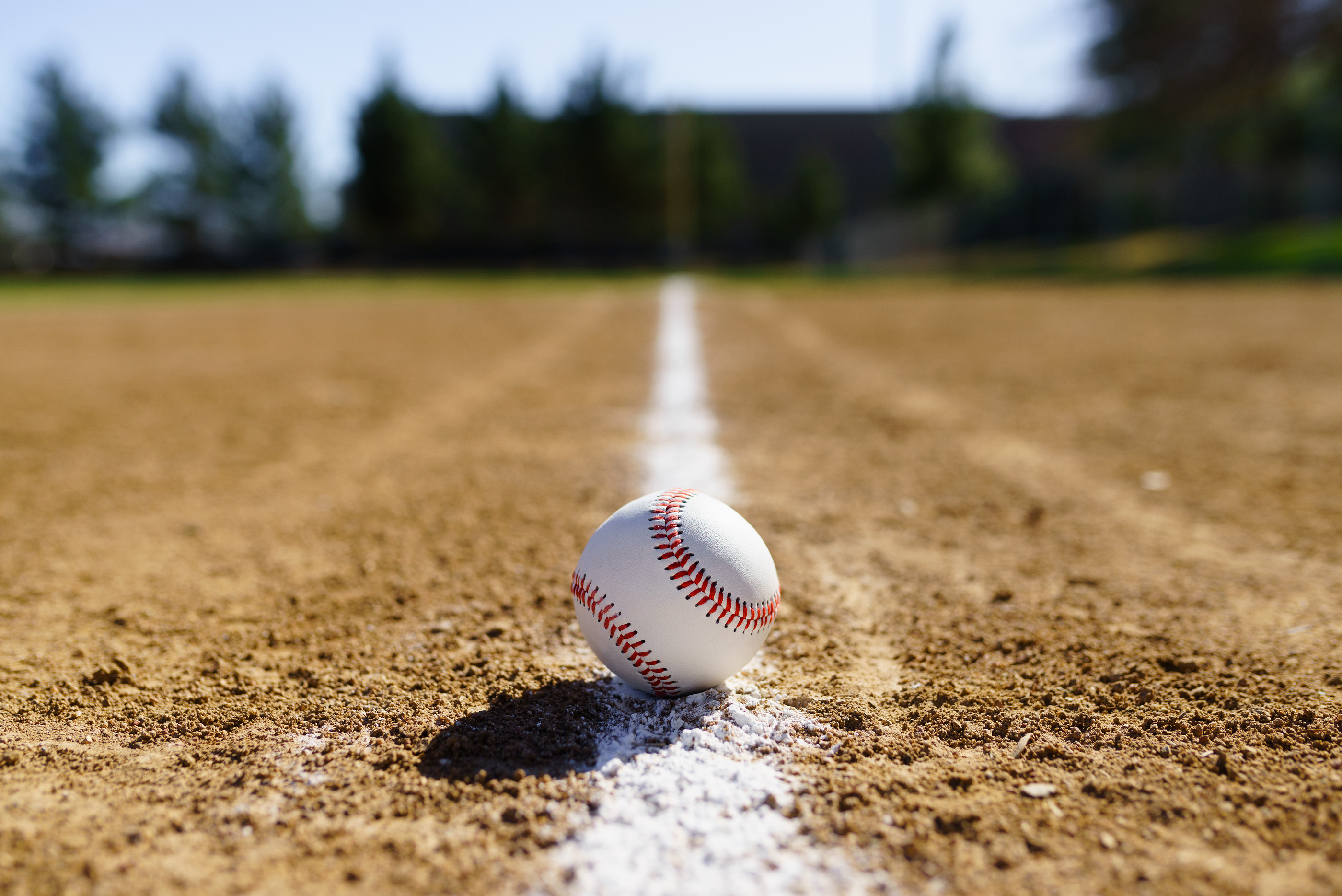 Baseball Laying On A Baseball Field Line